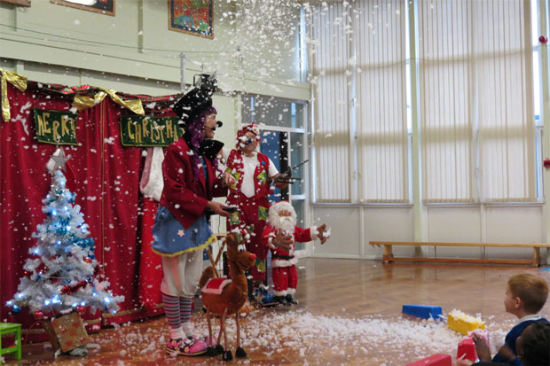 Kuki and Krums the clowns entertaining children for their special Christmas treat at Brindle Gregson Primary in Manchester.